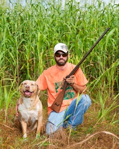 Dakota Smith, a local gunsmith and manager at Smith Family Ranch in Lakeland, with his dog, Nacho.  Photo by PEZZIMENTI